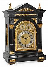 A Victorian large gilt brass mounted ebonised quarter chiming bracket clock J.W