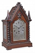 A William IV Gothic revival small carved oak library timepiece, Frodsham