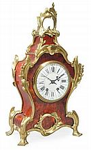 A French Louis XV style gilt brass mounted tortoishell mantel clock Retailed...
