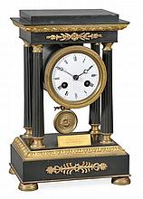 A French gilt and patinated brass small portico mantel clock Unsigned
