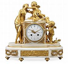 A French Louis XVI style ormolu mounted white marble figural mantel clock...