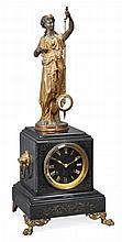 A French patinated spelter and gilt brass mounted figural mystery clock Guilmet