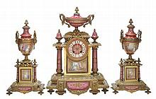 A French porcelain mounted ormolu mantel clock garniture Unsigned