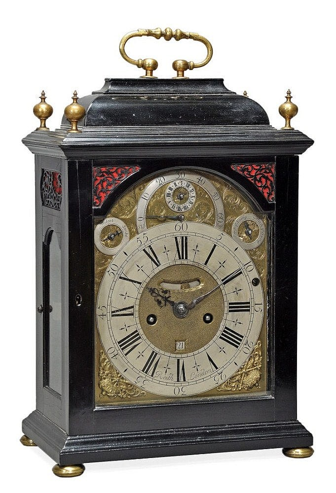 A fine and rare Queen Anne ebony quarter-chiming table clock with alarm...