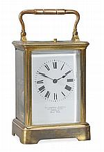 A French lacquered brass carriage clock with push-button repeat Retailed by...