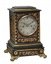 An ormolu mounted patinated bronze mantel clock Wilson & Gandar, London