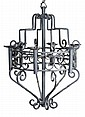 A wrought iron six light chandelier, 20th century,