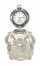 An Edwardian silver mounted moulded and cut glass inkwell with watch by...