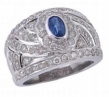 A sapphire and diamond ring, the central oval cut sapphire