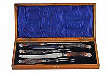 A late Victorian five piece carving set with stag horn and silver handles