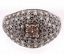 A diamond dress ring , the pave set ring with a central four claw set...