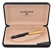 Aurora, a black resin and gold plated fountain pen