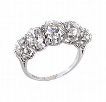 A diamond five stone ring, set with a row of five old brilliant cut diamonds