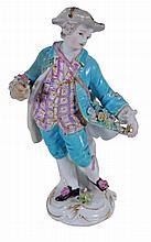 A Meissen figure of a young man , late 19th century, holding a posy in one hand