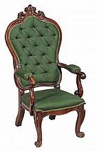 A Victorian rosewood armchair , circa 1850, with an arched padded back