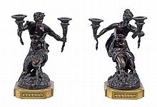 A pair of Continental patinated and gilt bronze mounted twin light figural...