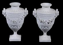 A pair of French bisque porcelain urns, 19th century
