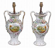 A pair of Staffordshire vases , circa 1840, with branch handles