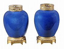 A pair of gilt metal mounted Chinese mottled blue ground porcelain vases