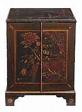 A black lacquer and gilt decorated cupboard , late 18th/ early 19th century