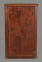 A mahogany hanging corner cupboard probably Anglo-Dutch , early 19th century