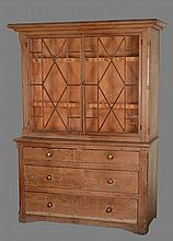 A pine dresser, early 19th century, the glazed top above two short and two...
