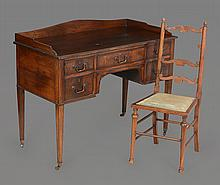 A mahogany kneehole dressing table , first half 20th century, 86cm high