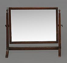 An oak swing frame toilet mirror, late 19th century, 42cm high, 48cm wide