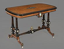 A mid Victorian ebonised and amboyna centre table , circa 1860