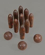 An antique set of floor skittles , possibly hornbeam, of London type