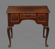 A George II walnut lowboy , circa 1740, with later crossbanding and stringing