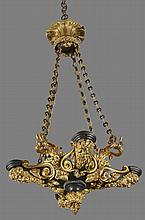 A late Regency patinated and gilt bronze four light colza chandelier