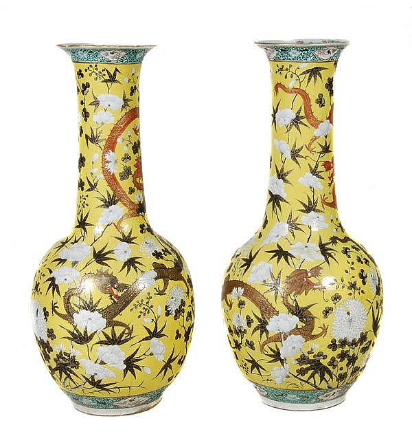 A pair of Chinese yellow-ground porcelain bottle