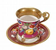 A Minton bone china claret-ground cabinet cup and