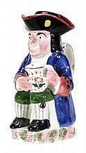 A British pottery Toby jug and cover of Portobello