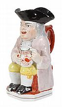 A Staffordshire pearlware Toby jug, typically
