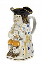 An English pearlware Pratt-type Toby jug,