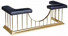 A brass and black leather upholstered club fender,