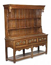 A George III oak dresser, circa 1790, with a plate