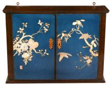 A mahogany cabinet with Japanese ivory and mother of pearl inset doors