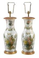 A pair of decalcomania glass vases, typically decorated with reverse-glass...