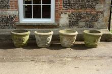 A set of four reconstituted stone garden planters, second half 20th century
