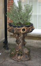 A Victorian or Edwardian stoneware planter modelled as a tree trunk, circa 1900