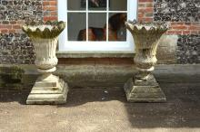 A pair of stone composition garden urns, second half 20th century