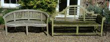 A teak garden seat in the manner of designs by Lutyens