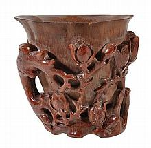 A large bamboo libation cup of lobed, tapered form