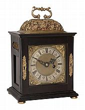 A fine James II gilt brass mounted ebony small basket top table timepiece...