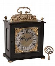A fine Charles II gilt brass mounted ebony small basket top table clock with...