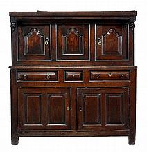 An oak court cupboard, dated 1755, the upper