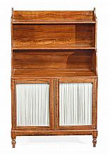 A Regency simulated rosewood waterfall bookcase, circa 1815,